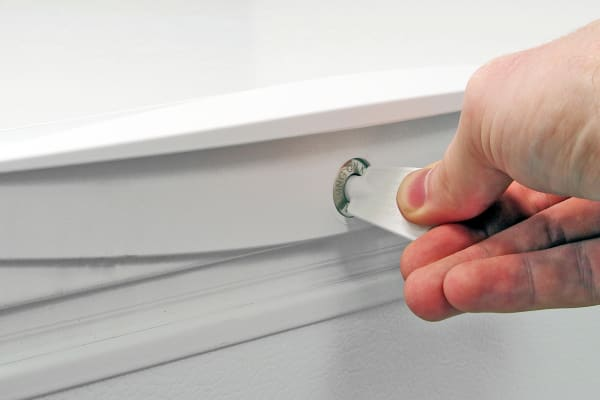 The door lock is easy to access, and helpful for keeping the door shut if the Kenmore 16542 is brimming with food.