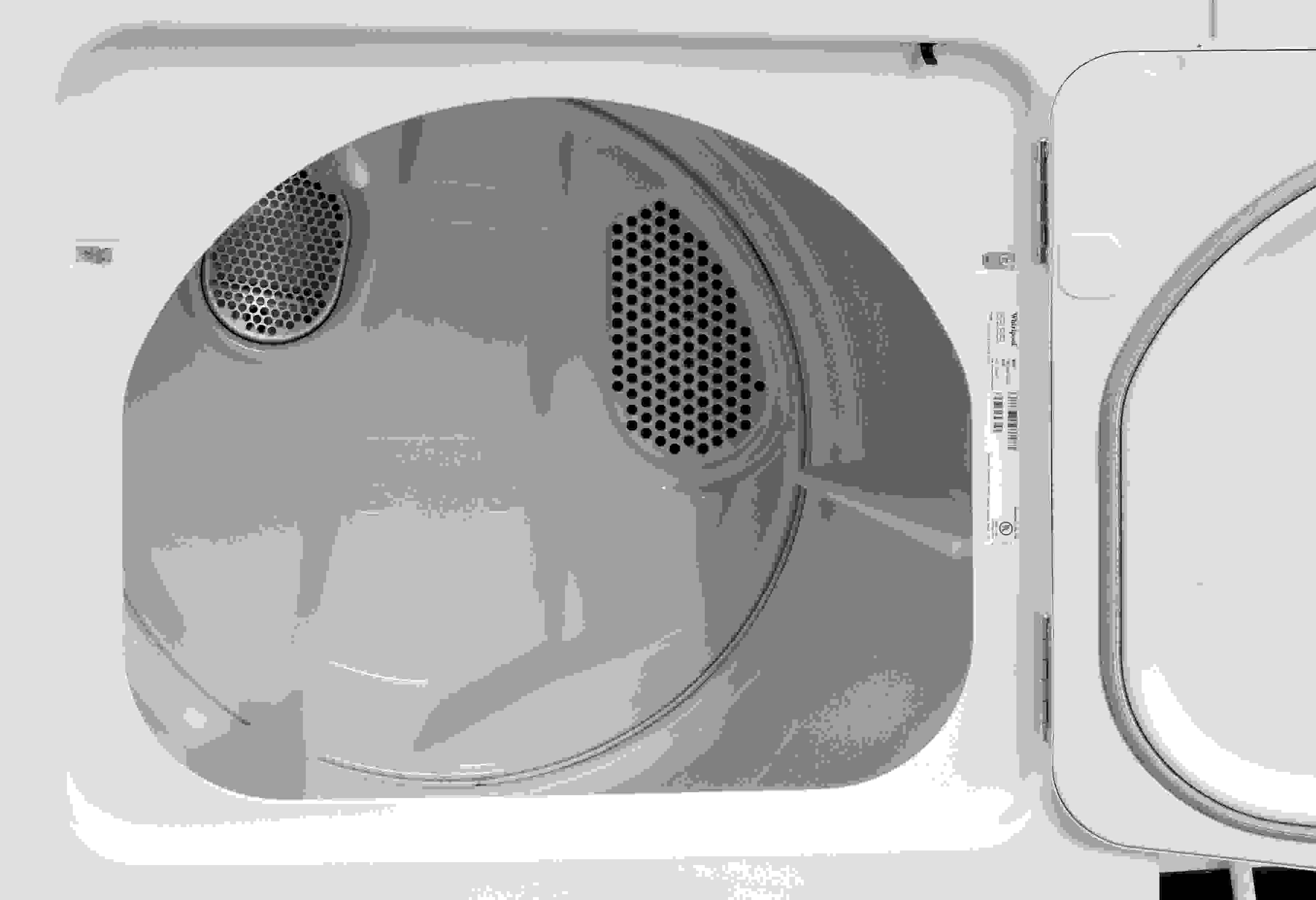 The Whirlpool WED4815EW has a white drum and no internal light—common features on models in this price range.