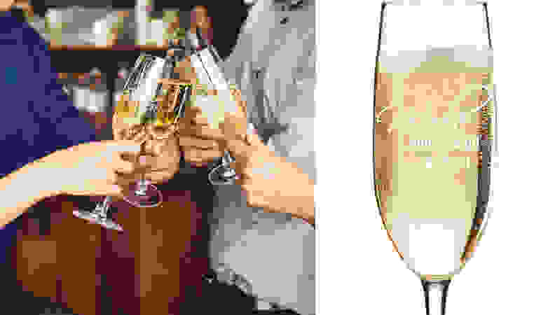 hands clinking champagne glasses