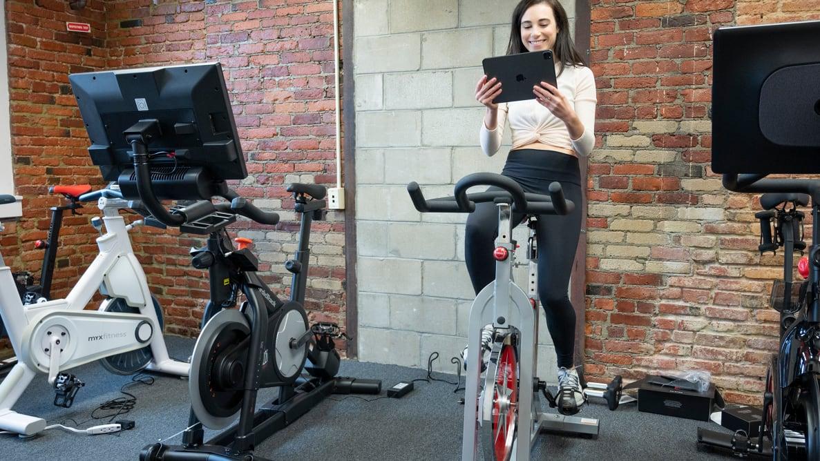 woman sitting on exercise bikes