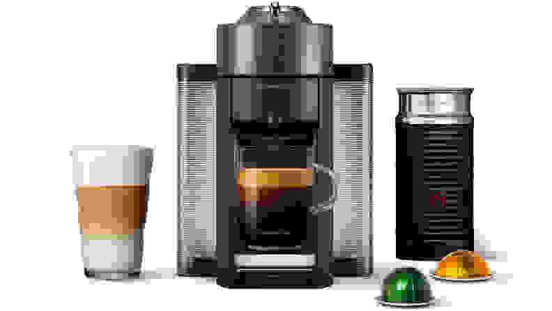 A black Nespresso Evoluo single-serve coffee maker.