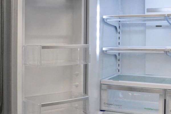 The twin fridge doors offer identical storage, except for the single dairy bin found on the left side.
