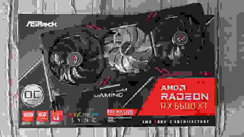 An AMD graphics card on top of its packaging.