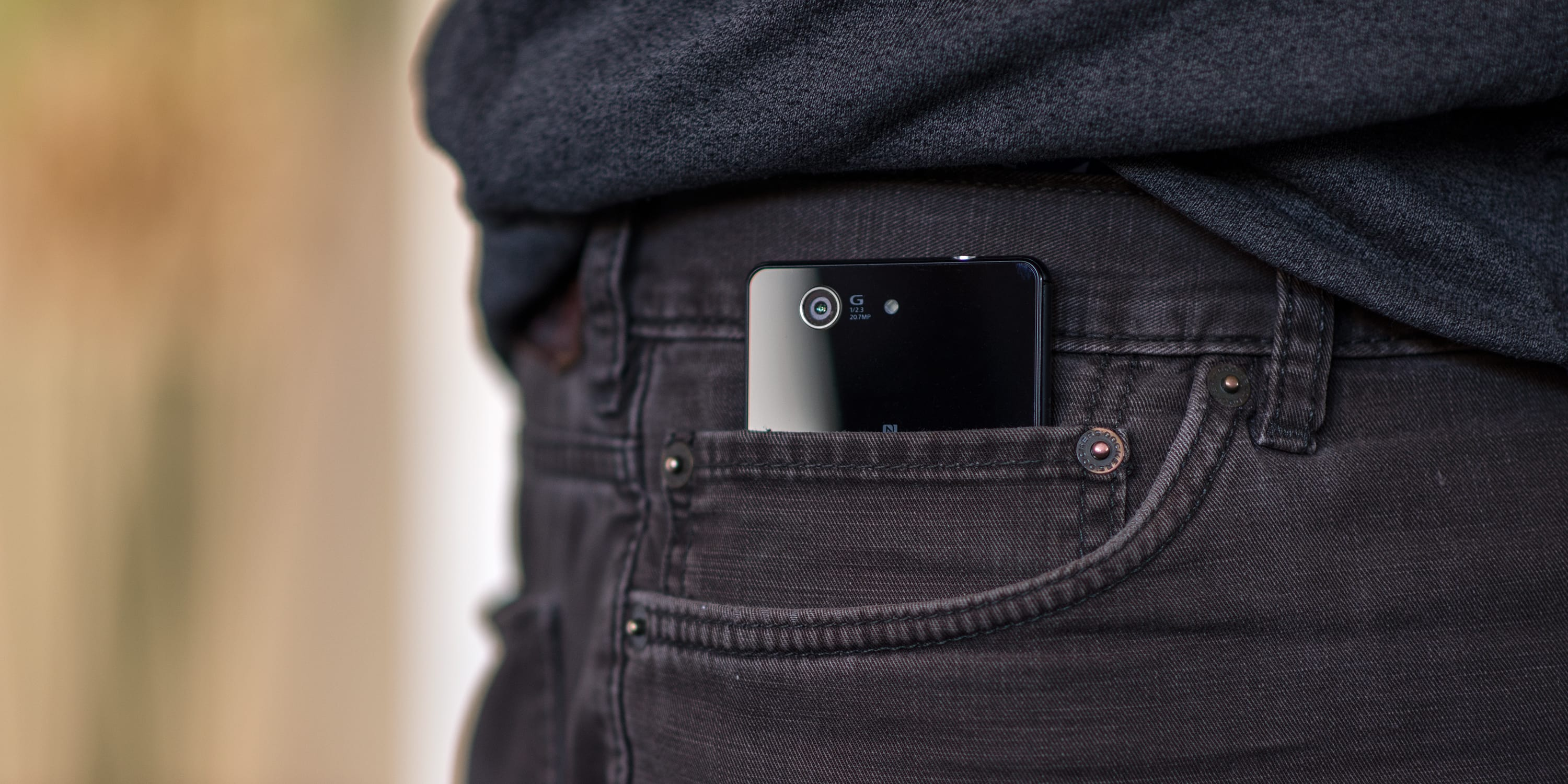 A photograph of the Sony Xperia Z3 Compact in a pocket.