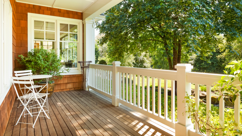 Spacious front porch of house on a sunny day.
