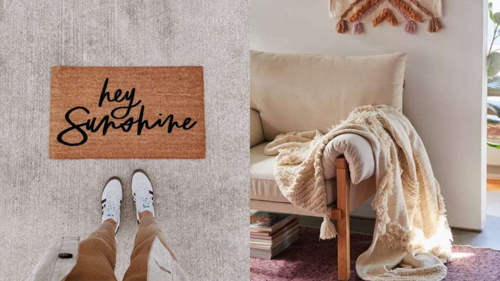 "Doormat with the words ""hey sunshine"" and throw blanket hanging over a chair."