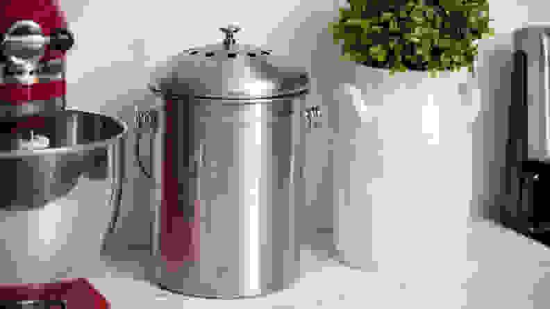 Metal compost bin on counter