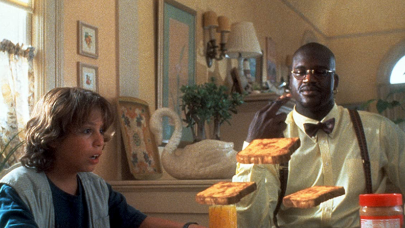 A still from 'Kazaam' featuring Shaquille O'Neal and Francis Capra.