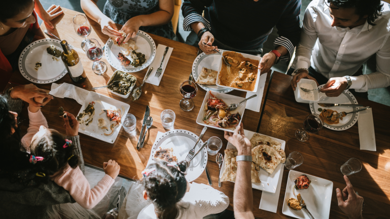 Family enjoying a meal around a table