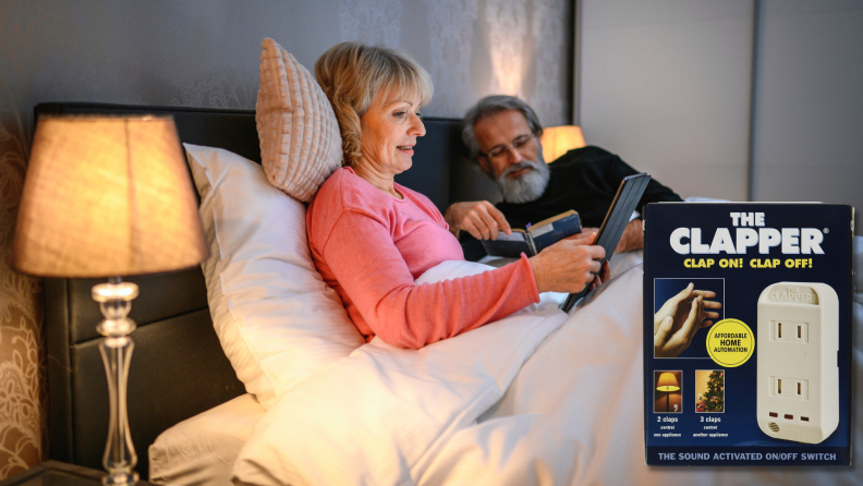 A couple reads in bed with a light on.