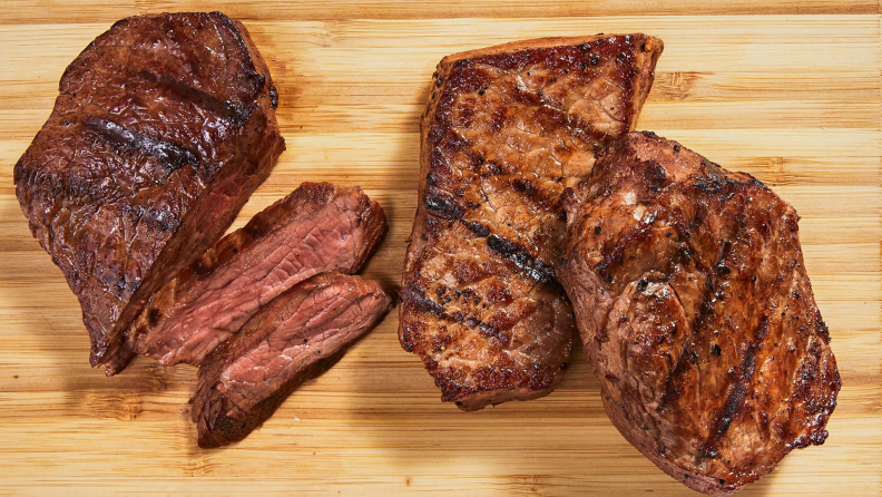 Cooked steak on a wooden cutting board