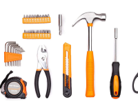 Tools including a hammer, screwdriver, pliers, and scissors are arranged.