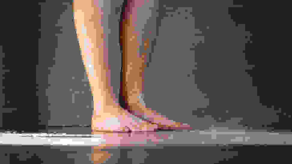 A Person Washing Their Feet