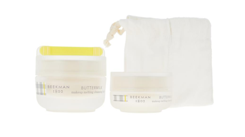 An image of a set of skincare including a cloth bag and two containers of makeup removing cleanser
