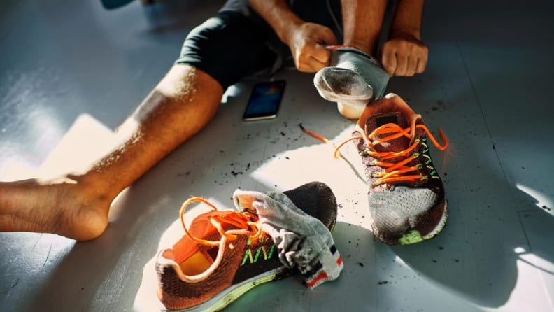 Man taking off dirty running shoes