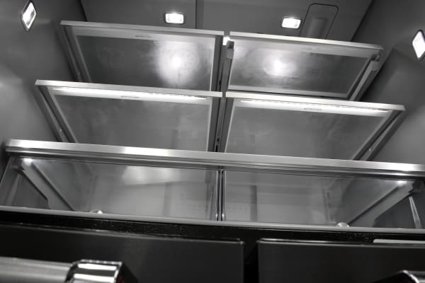 Two of the KitchenAid KRMF706EBS's fridge shelves feature under-the-trim LED lighting, adding to interior visibility.