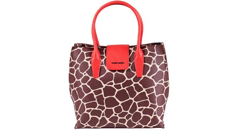 An image of a wide giraffe printed tote with red handles.