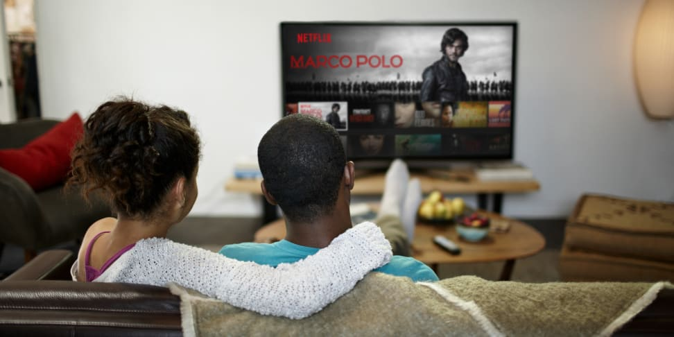 A couple enjoys Netflix programming