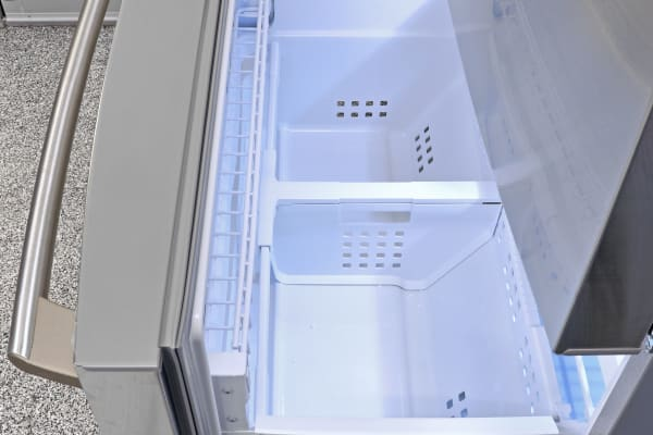 The pull-out freezer in all models is quite straightforward, and includes a small wire shelf just inside the door.
