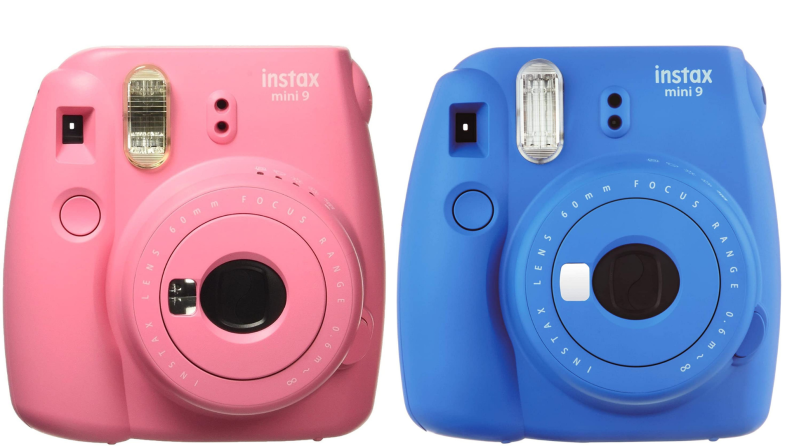 Two pink and blue Fujifilm polaroid cameras side by side.
