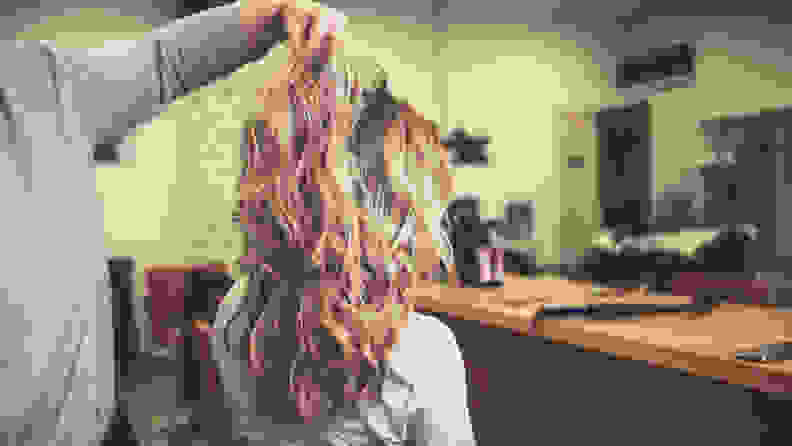 Woman with curly hair at the salon