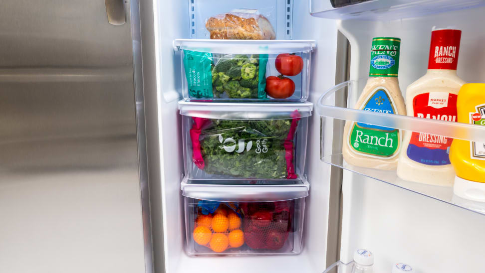 The Frigidaire FFSS2315TS's three crisper drawers, each filled with with fruits and vegetables.