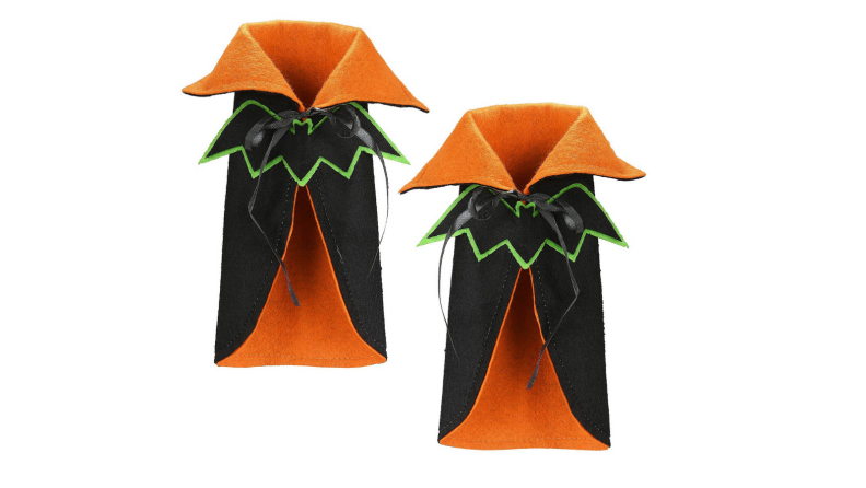An image of two high-necked capes in orange and black.
