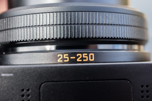 The 10x zoom ratio of the ZS100 is a 35mm equivalent of 25-250mm.