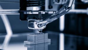 A 3D printer working.