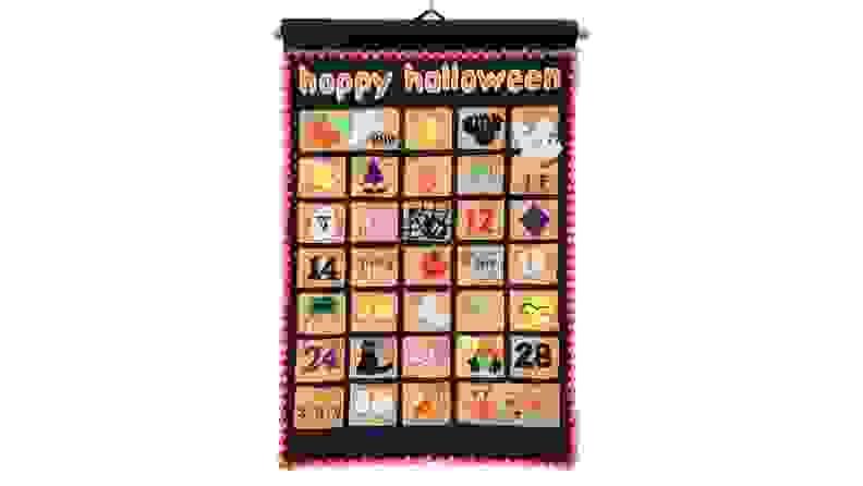 Colorful black felt Halloween-themed advent calendar.