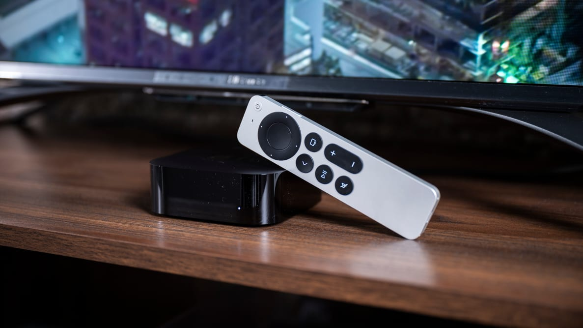 The Apple TV 4K (2021) with remote next to a TV