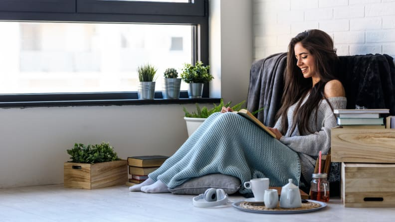 Woman under a blanket