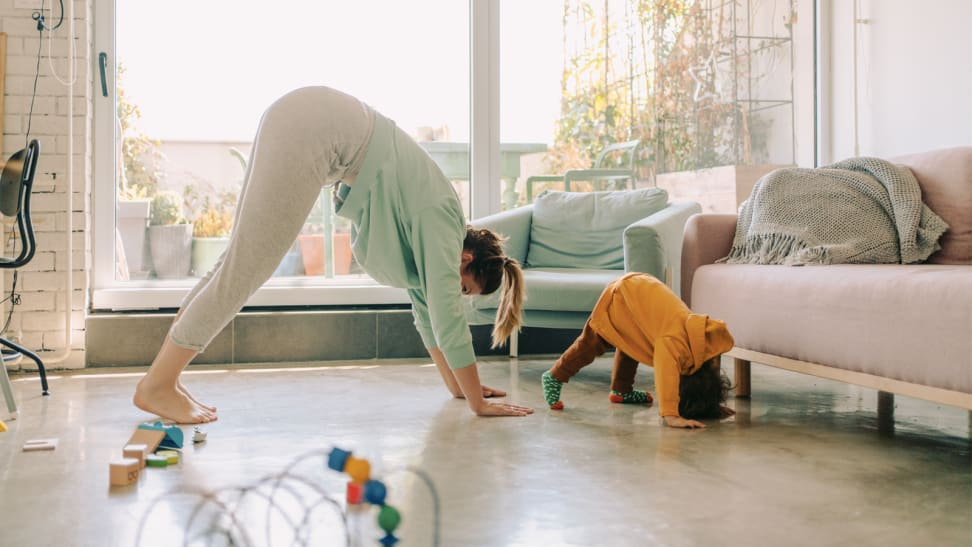 A woman and a child do yoga together