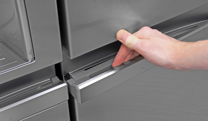 The LG LSC22991ST's handles use a hinge similar to what you'd find on a car door.