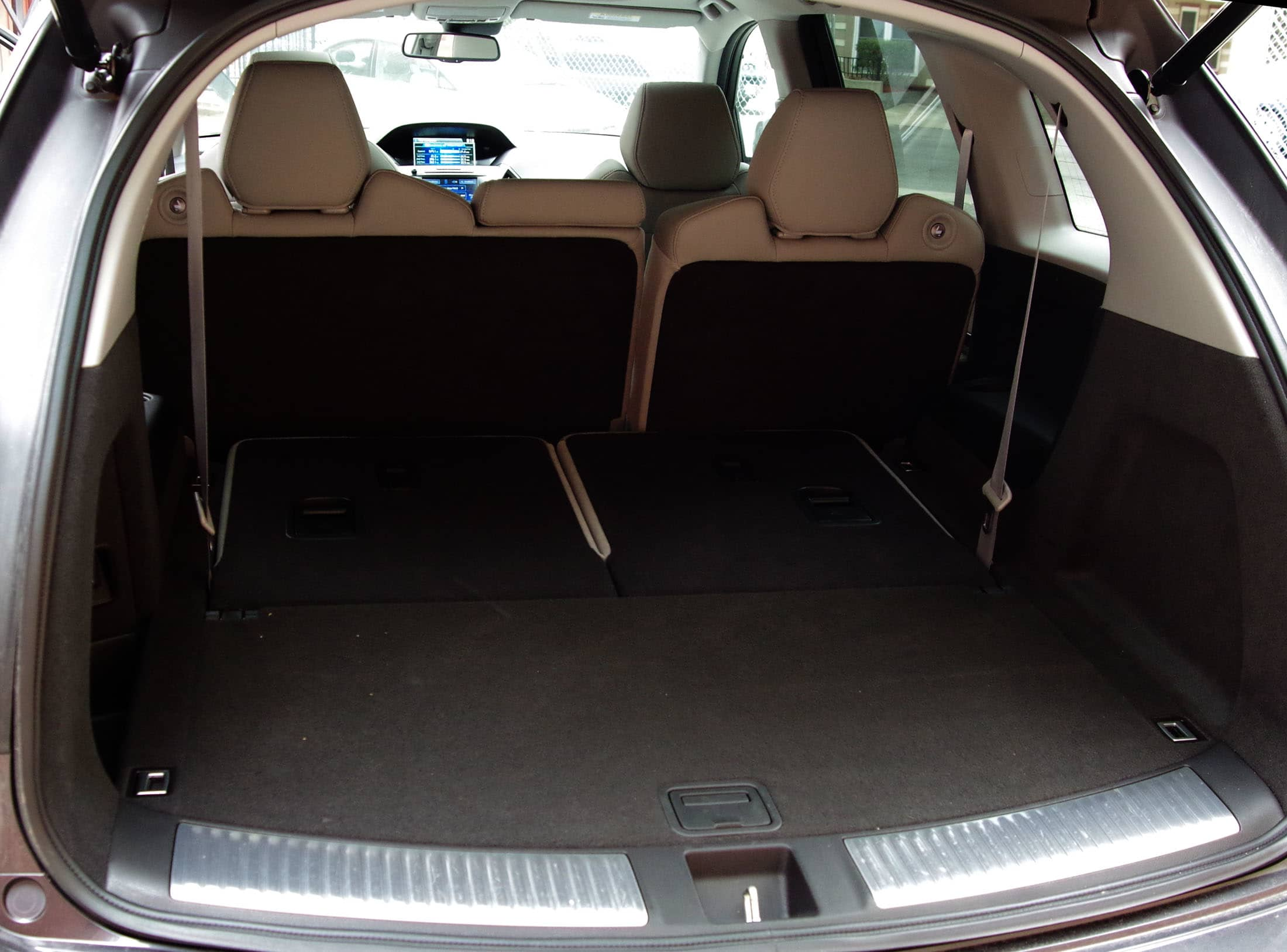 The 2014 Acura MDX's rear cargo area with the third row folded down.