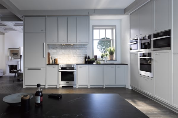 A suite of Miele appliances, including a 30-inch induction range.