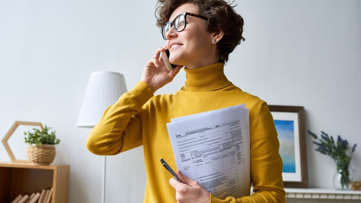Woman carrying tax documents