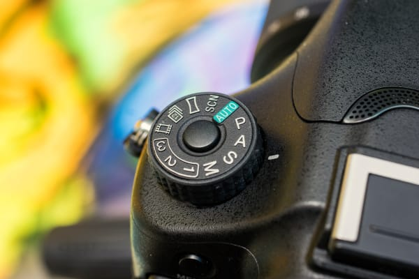 The mode dial requires you to push the center to turn. This keeps you from accidentally switching modes while shooting.
