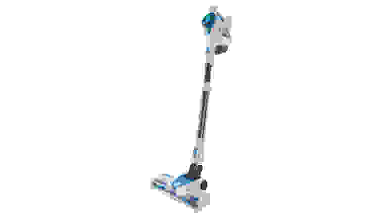 A blue and white Kenmore cordless stick vacuum standing upright on a white background.