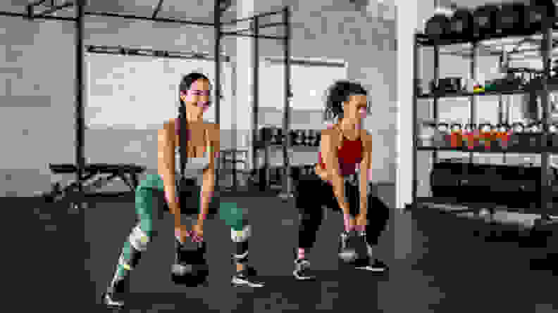 Two women exercising together.