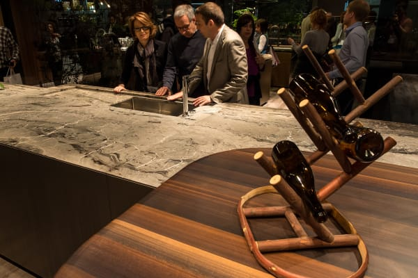 Rossana eschewed granite and paired its dark wood countertop with luxurious marble.