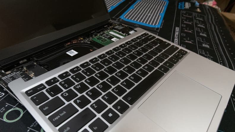 The keyboard and touchpad lay atop the bare processor board.