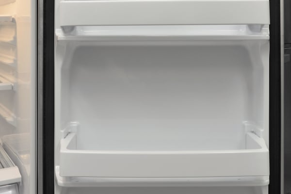 Fridge door shelves in the GE GAS18P aren't adjustable, but fortunately it's deep enough for gallon storage. The varying heights should also suit taller items like wine and soda bottles.