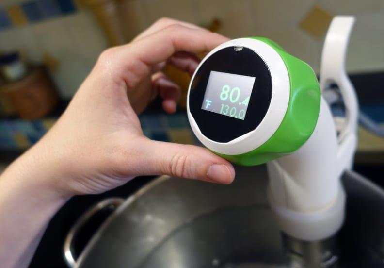 Nomiku temperature control knob in use