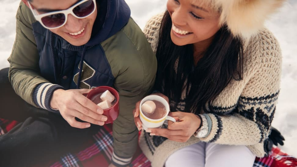 Hot cocoa will keep you warm at this outdoor gathering.