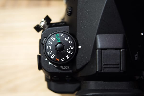 The K-1's mode dial offers five custom shooting modes in addition to the usual choices.