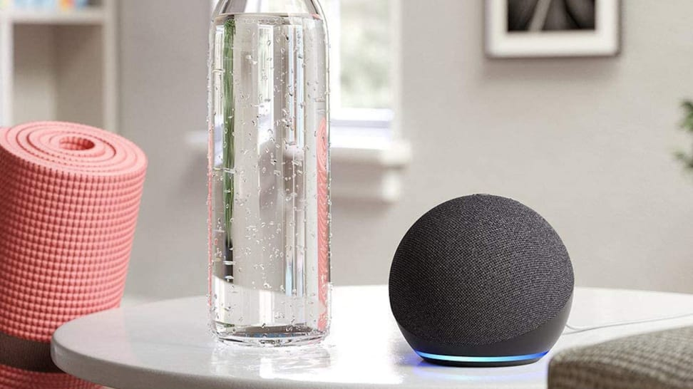 The Amazon Echo Dot 4th Generation on a white coffee table.