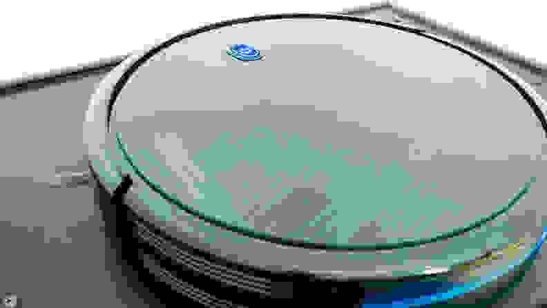 The Eufy Robovac 11s in a white room viewed from above at a slight angle.