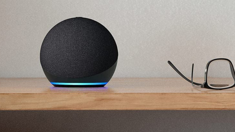 An Amazon Echo Dot sits on a table.