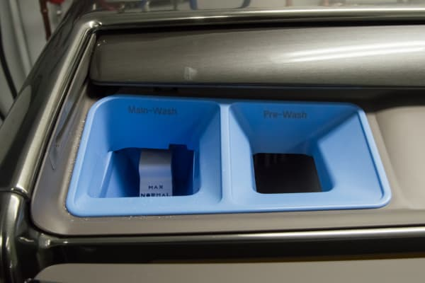 The dispensers are located on top of the machine.